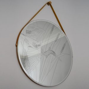 Daniel Heath Heronry Engraved Circular Mirror with waxed ply frame hanging on a wall.. Curious Egg.