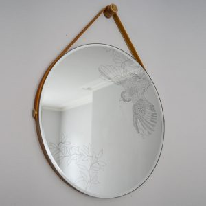 Daniel Heath Swooping Jay Engraved Circular Mirror with waxed ply frame haning on a wall. Curious Egg.