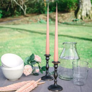 sorbet coloured taper candles on wedding table