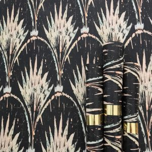 Pearl Wallpaper by Anna Hayman at Curious Egg. Lifestyle Image with rolls of wallpaper in the foreground.
