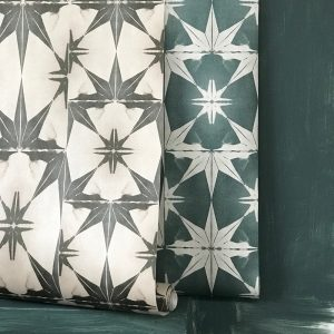 Wanderlust Wallpaper by Anna Hayman at Curious Egg. Lifestyle Image showing the wallpaper in two colours - teal and blush.