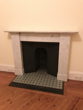 Edinburgh New Town Apartment period features - original marble and cast iron fireplace with tiled hearth.