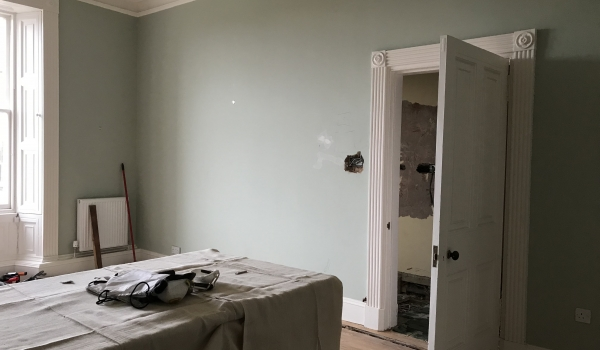 blank wall area in kitchen with green blue wall