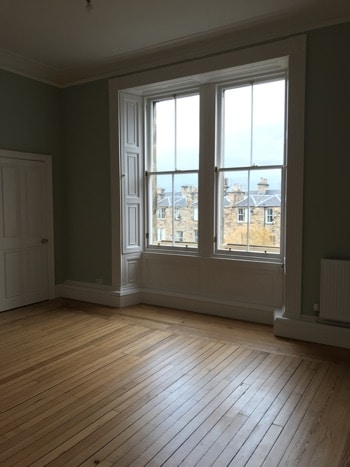Edinburgh New Town Apartment period features - kitchen window with shutters, sash and case window frames and original floorboards