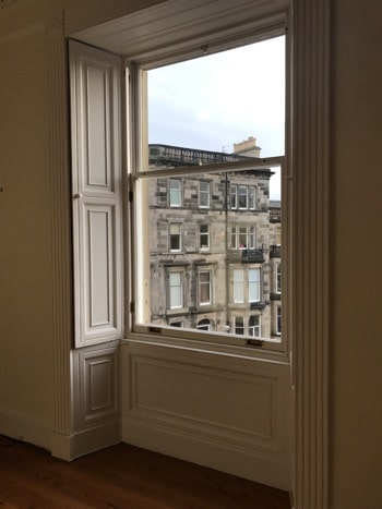 Edinburgh New Town Apartment with Period Features - Bedroom window shutters with view