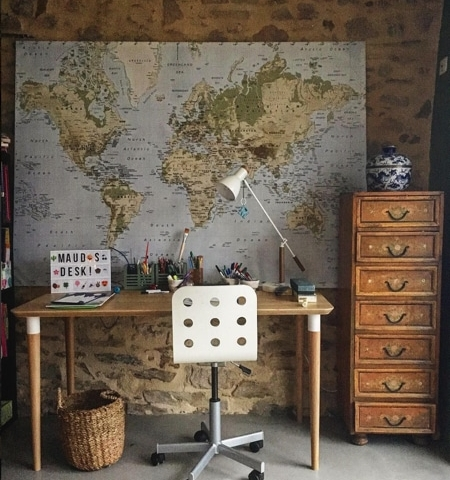large map on wall of girls bedroom