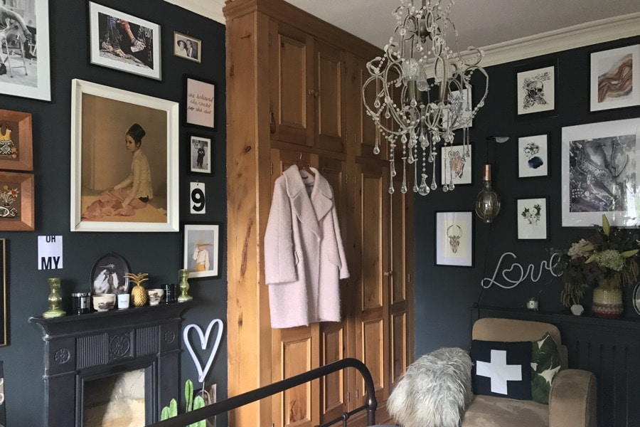 gallery wall in eclectic dark interior