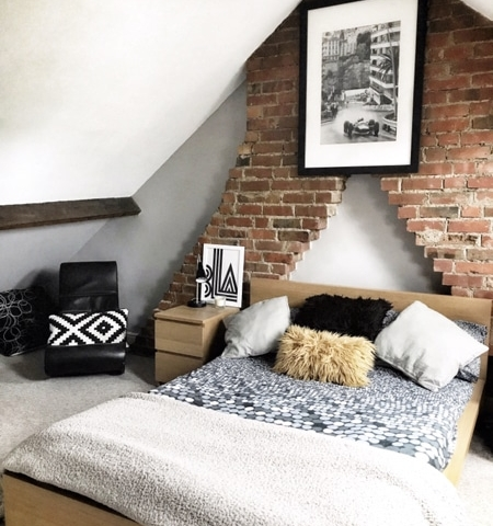 loft room with bare brick wall and textured decor