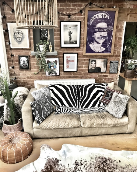 eclectic living room with gallery wall and zebra rug on sofa
