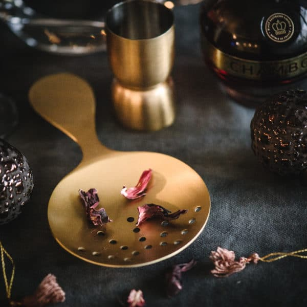 brass cocktail strainer with hibiscus flowers