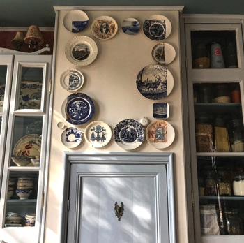 a collection of antique plates on display