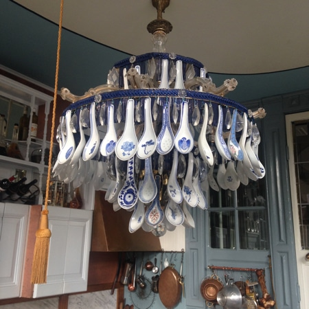 Helma's statement chandelier made with 88 chinese porcelain spoons and five different vintage chandelier parts.