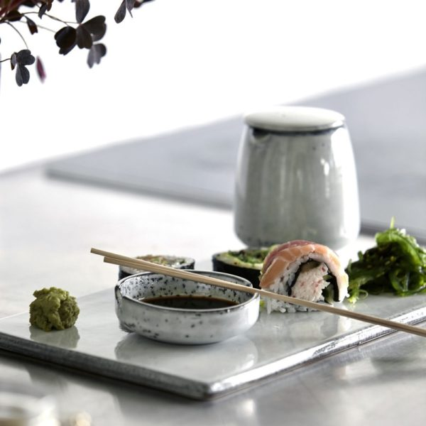 Curious Egg Small Lidded Serving jug in off-white ceramic. Lifestyle image with sushi and soy.