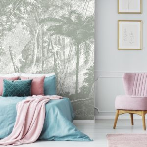 Amazonia wall mural by Feathr in grey colour.  Lifestyle image with bed and chair.