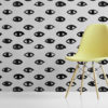 ISeeU wallpaper by Feathr in grey.  Lifestyle image with chair in foreground.