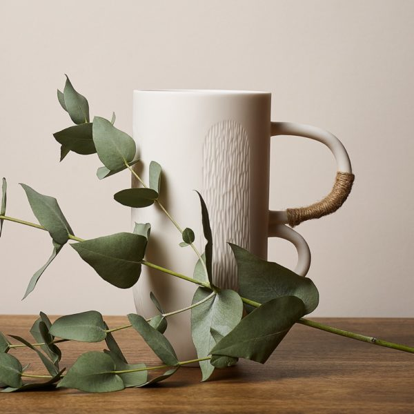 Sibling Vase by Speckled Grey - Reed. Porcelain vase with reed pattern finish and handles. Lifestyle image with plants.