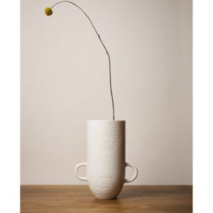 Sibling Vase by Speckled Grey - Scallop. Porcelain vase with scallop finish and handles. Lifestyle image with plants.