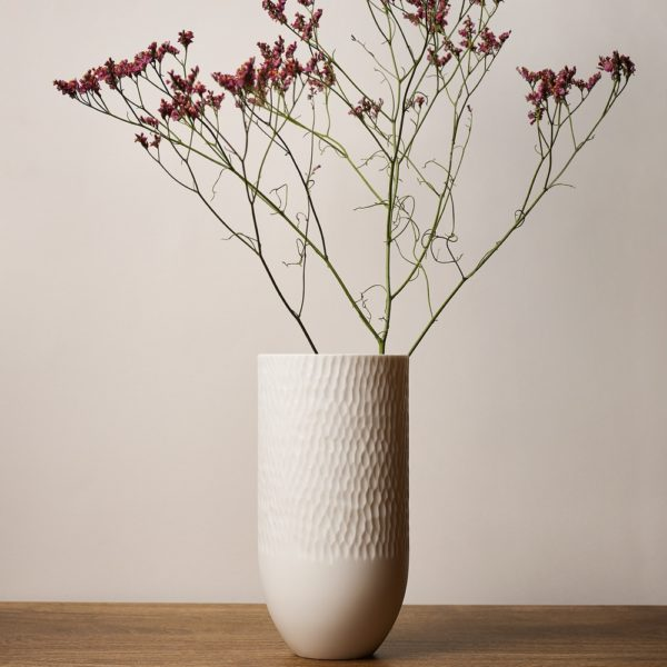 Sibling Vase by Speckled Grey - Scallop 2. Porcelain vase with scallop pattern finish. Lifestyle image with plants.