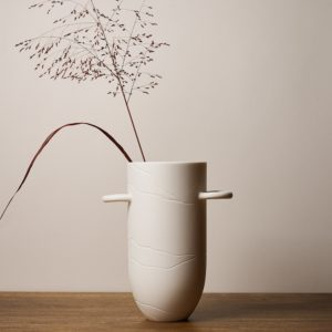 Sibling Vase by Speckled Grey - Vein. Porcelain vase with vein pattern and handles. Lifestyle image with plants.