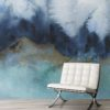 Feathr Mystic wallpaper mural in teal colour.  Lifestyle image with a chair in the foreground.