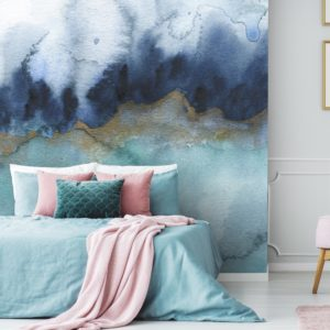 Feathr Mystic wallpaper mural in teal colour.  Lifestyle image with a bed in the foreground.
