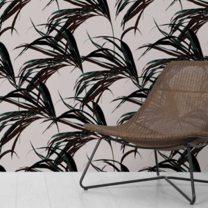 Feathr Winter Palm wallpaper in green colour lifestyle image with a chair in the foreground
