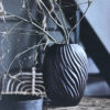 Curious Egg Grande Orinoco dark coloured sculptured glass vase with autumnal branches