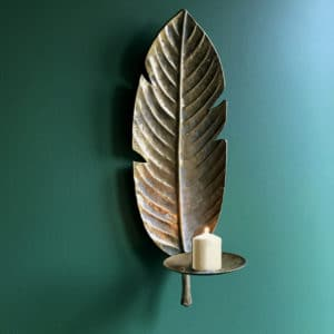 Gold Banana Leaf wall sconce on a green backgorund curious egg