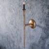 Curious Egg Gold Stem Wall Sconce Lifestyle image.