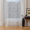 Ayrshire Lace Window Panel - Beth Design.  Lifestyle image of panel hanging in front of a traditional window.