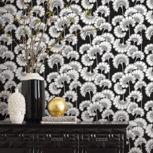 Florence Broadhurst Japanese Floral Wallpaper Black at Curious Egg on wall with shelf books and vase with flowers