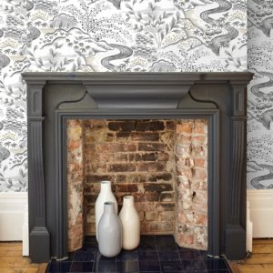 Florence Broadhurst Waterfall Gardens Wallpaper in Neutral on wall surrounding fireplace at Curious Egg