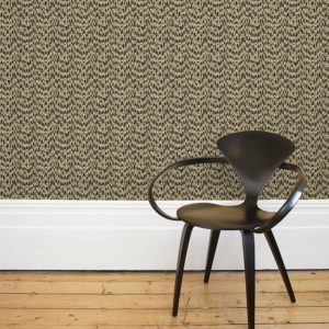 Florence Broadhurst Waterjet Wallpaper in Black & Gold with chair in foreground at Curious Egg
