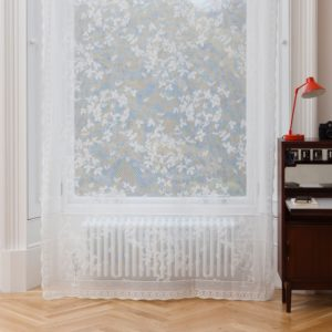 Ayrshire Lace Window Panel - Honey Bee Design.  Lifestyle image of panel hanging in front of a traditional window.