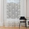 Ayrshire Lace Window Panel - Rennie Design.  Lifestyle image of panel hanging in front of a traditional window.