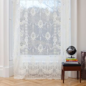 Ayrshire Lace Window Panel - Skye Design.  Lifestyle image of panel hanging in front of a traditional window.