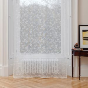 Ayrshire Lace Window Panel - Vicky Design.  Lifestyle image of panel hanging in front of a traditional window.