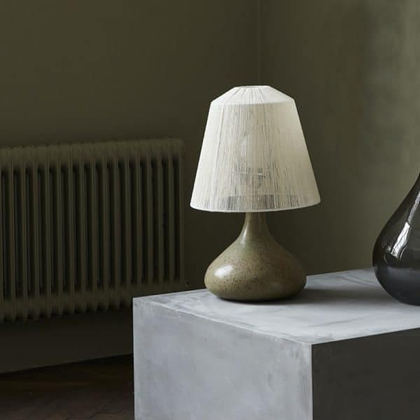 Manto String Lampshade on glass lamp base on table
