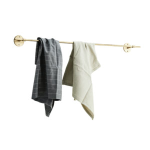 Gold towel rail with dishcloths hanging from it