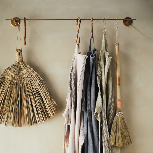 gold towel rail with clothes hanging from it