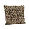 printed boho cushion with pinks and green floral design agianst plaster wall with olive green candle