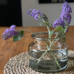 Curious Egg small glass jar vase - lifestyle image with lilac budlia flower stems.
