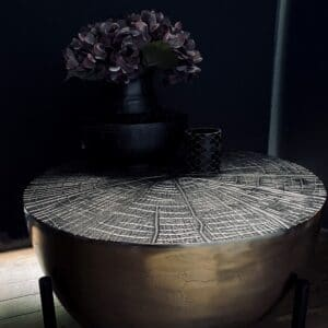 brass coffee table with tree like texture