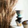 modernist style colourful vase with pampas grass on window ledge