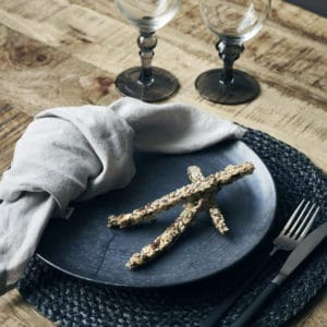 black dinner plates with napkin and biscuits