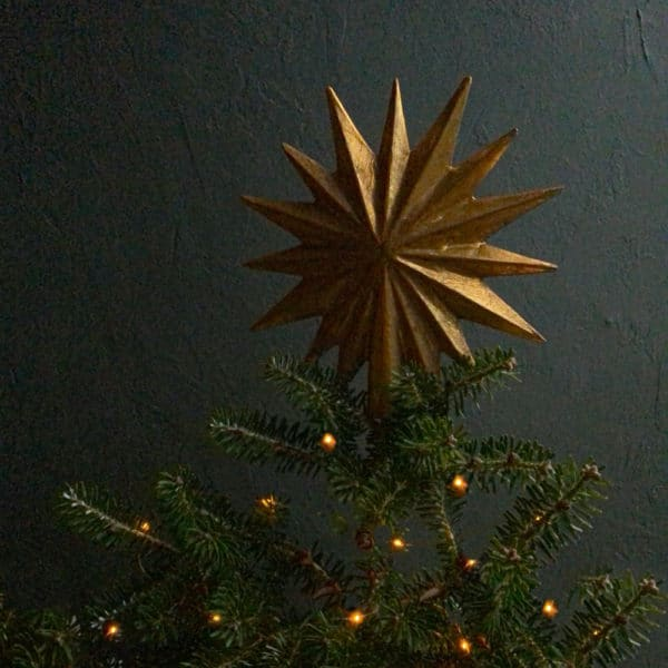 Gold Star Tree Topper on Christmas tree