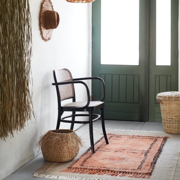 Curious Egg Kahaia Fringed Basket lifestyle image f the basket displayed in a hallway