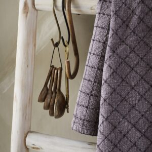 wooden measuring spoons hanging in kitchen