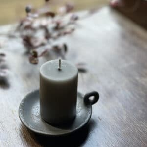 mink grey candle on dining table