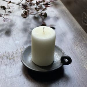 ivory stumpy candle on table